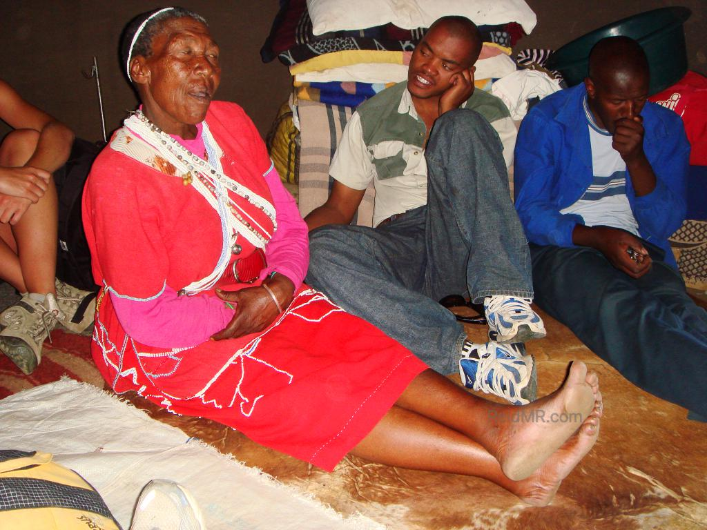 Lesotho medicine woman, an elderly woman with people around her