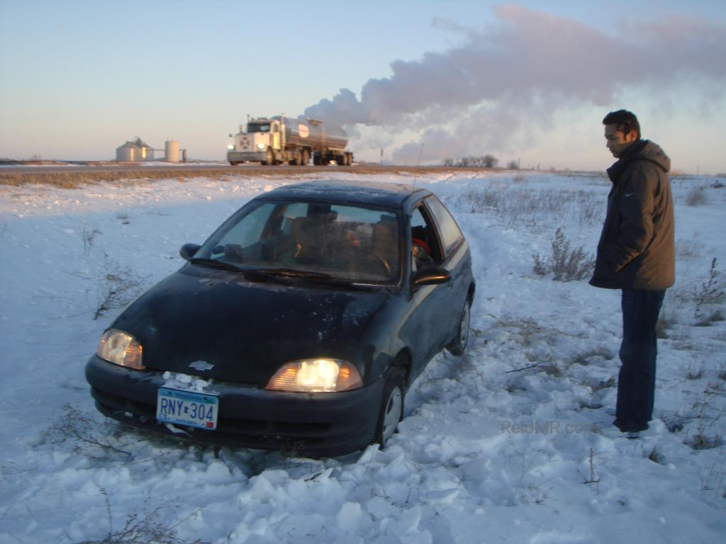 Sumedh standing by my car with the tracks in the background