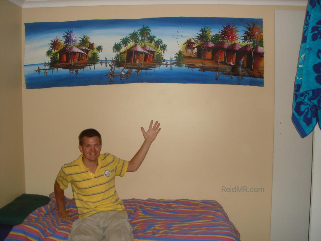 Posing with the great huge painting I just got. A scene with villages on water. Great colors with blue as a dominant hue.