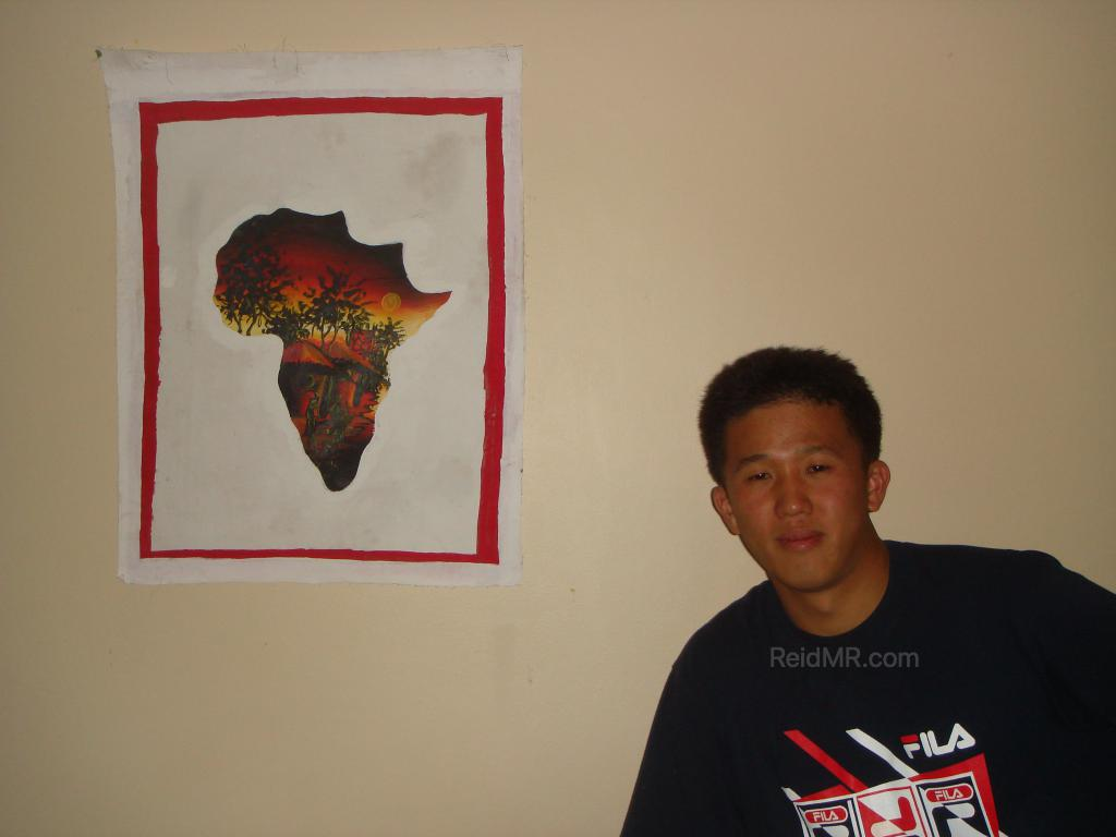 Matsu posing with my other painting, a map of Africa.