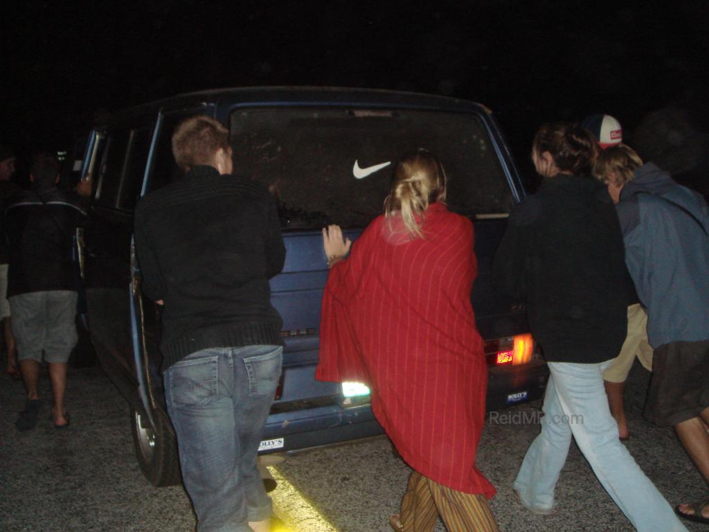 Pushing the van at night off the road.