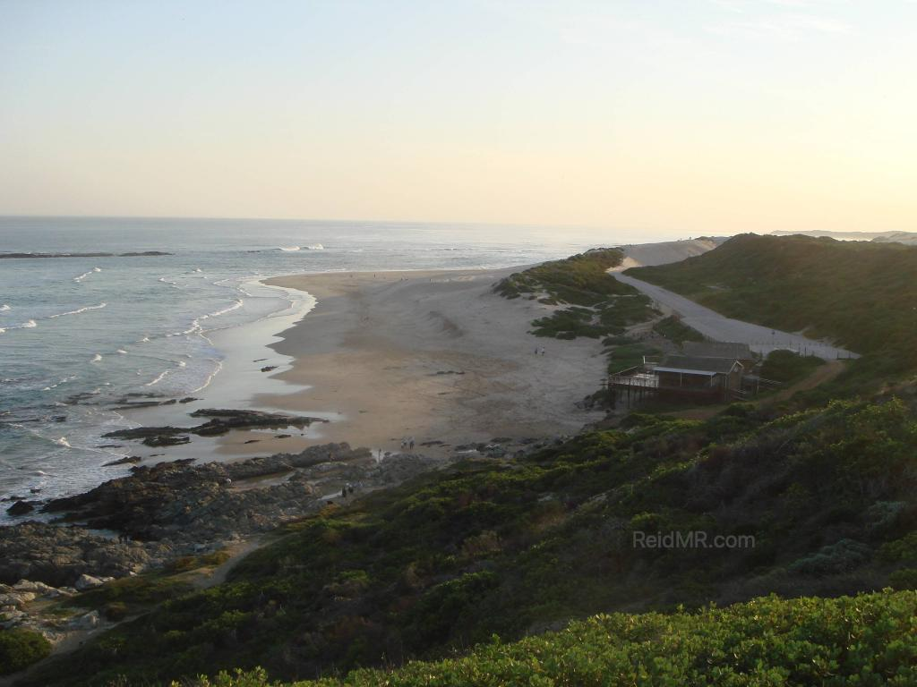 Sardinia Bay, a great overview of the bay from a high vantage point near sunset, with the greenery and ocean in view.
