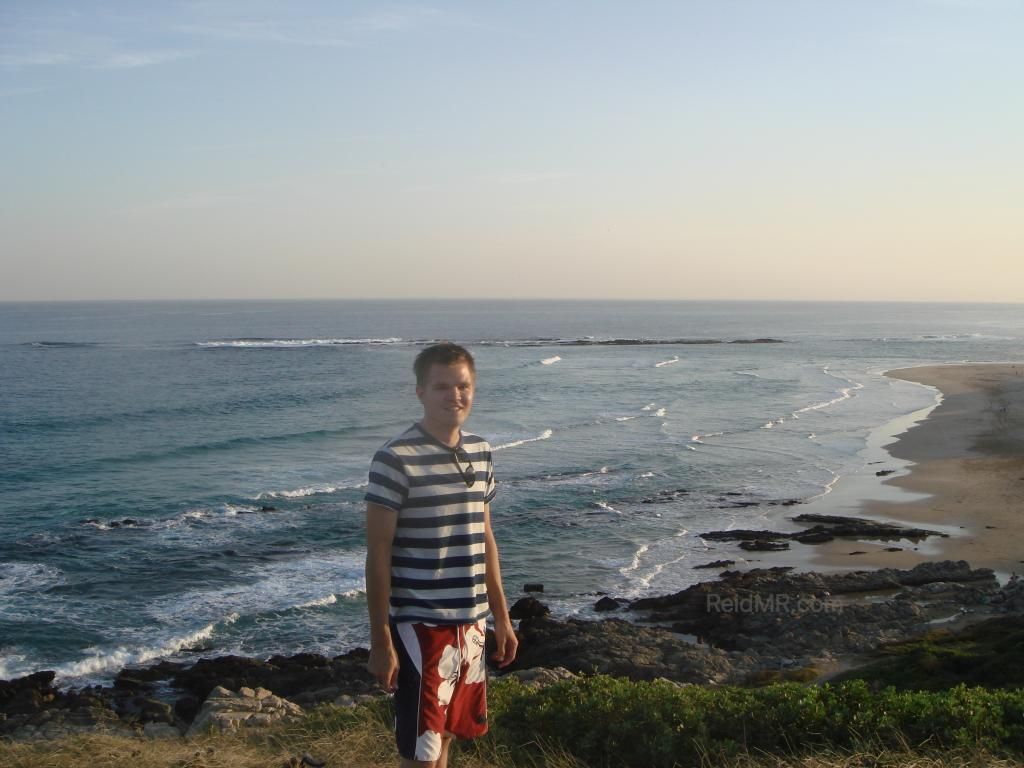 Me at Sardinia Bay, a great overview of the bay from a high vantage point near sunset, with the greenery and ocean in view.