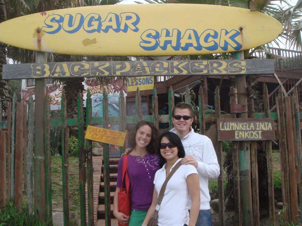 A group of us friends in front of the Sugar Shack sign.