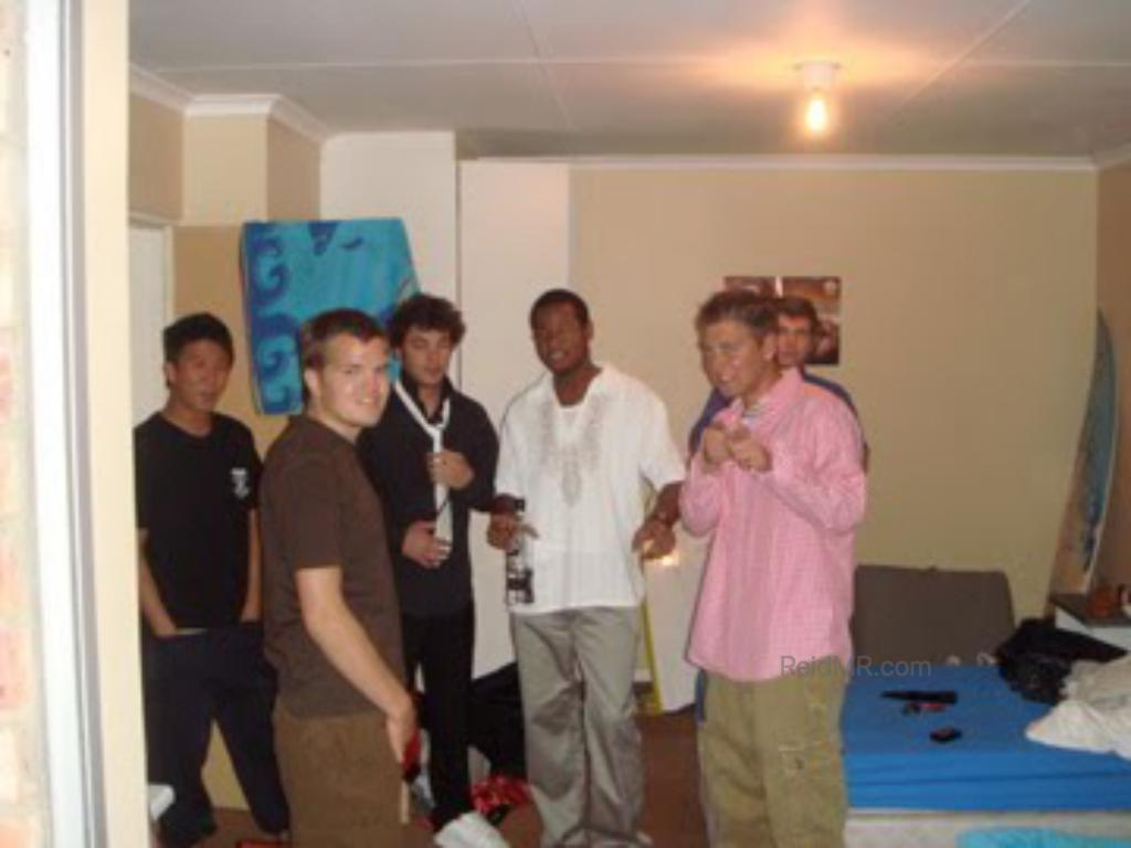 A bunch of guys ready to go outside, after finishing getting ready.