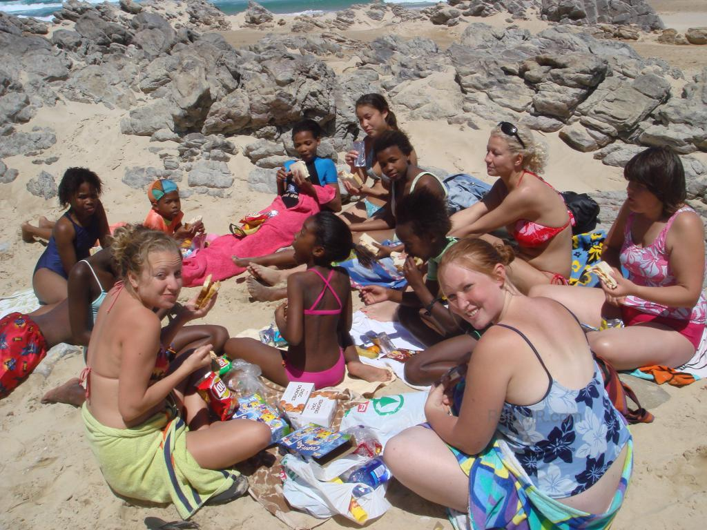 At Sardinia Bay with our students, sitting on the sand.