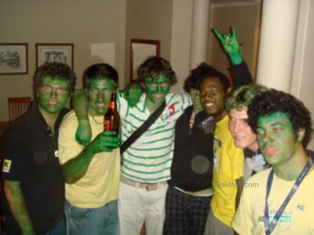 The guys with painted green faces ready to watch the rugby game.