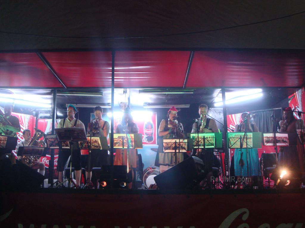 A group of musicians on stage at the Octoberfest festival.