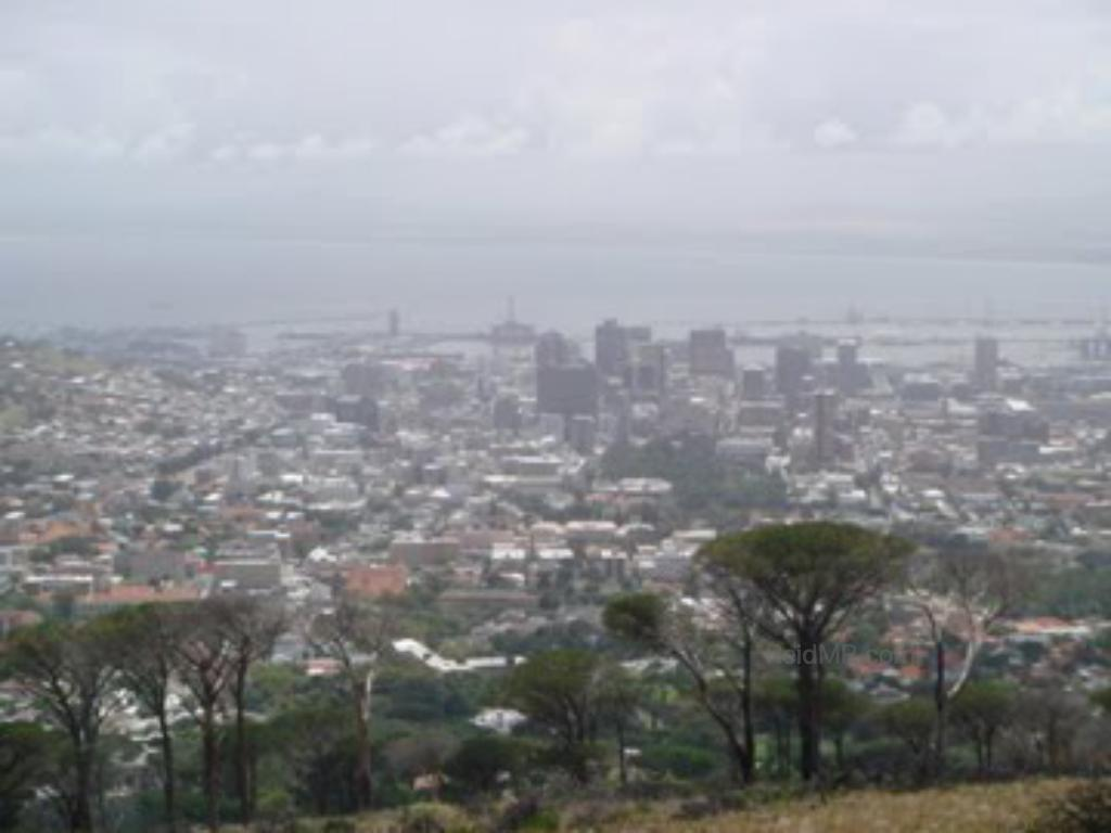 A smoggy or cloudy picture overlooking Cape Town.