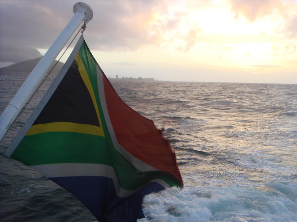 Sea Princess's South African flag with the ocean and sun in the background.