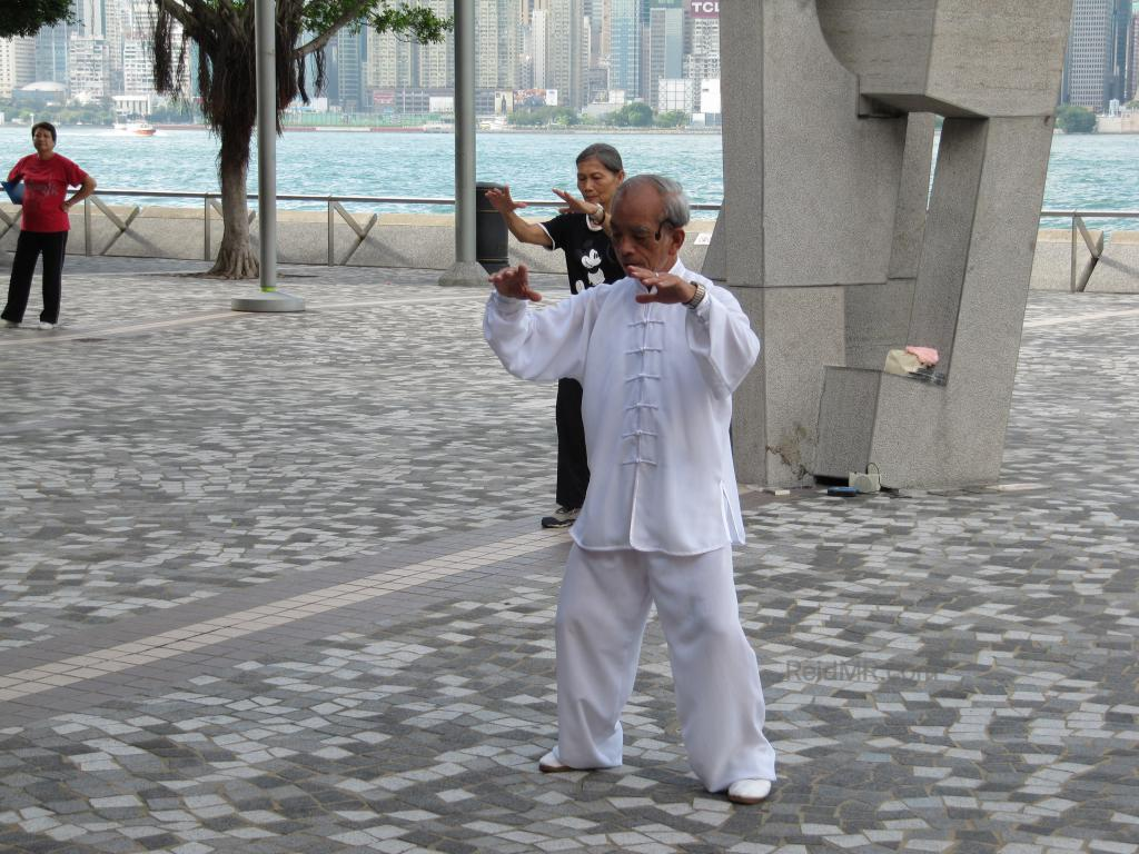 At the waterfront, the Tai Chi teacher in white.