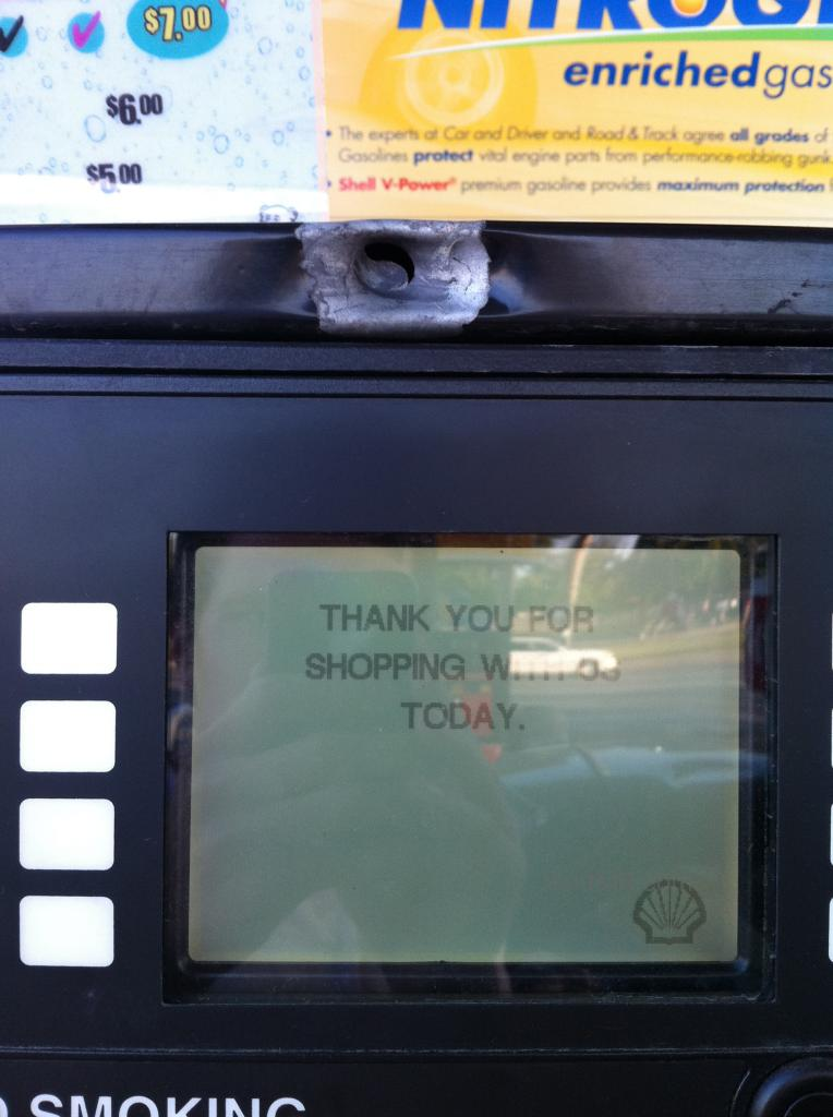 Gas pump with a big bullet hole in it in Columbus Ohio
