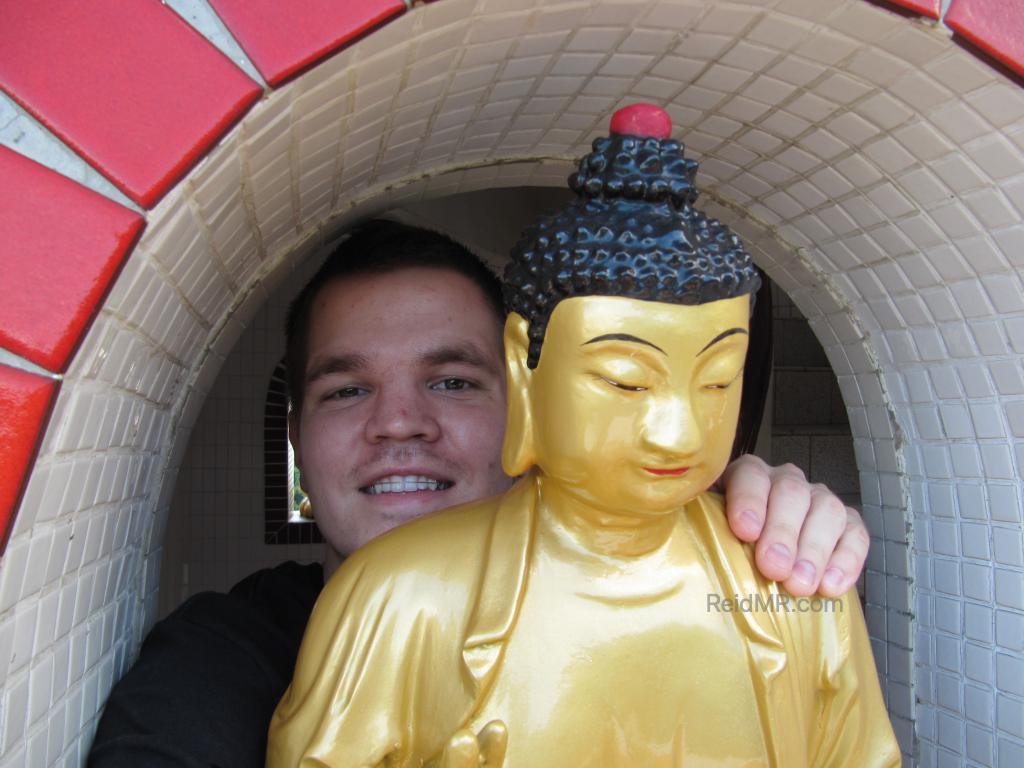 Me hugging a buddhist statute.