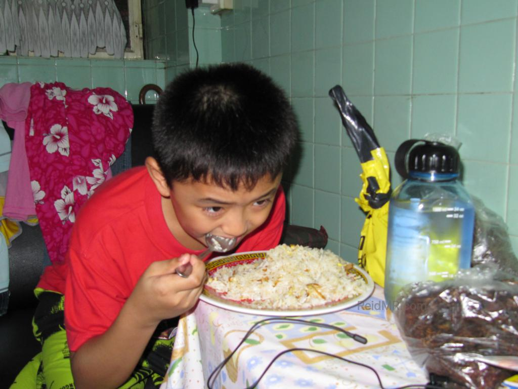 Marv is eating his fried rice, probably the first time he has cooked.