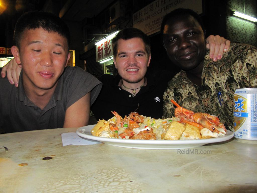Matsu, myself and a stranger eating rice outside on the Hong Kong street.