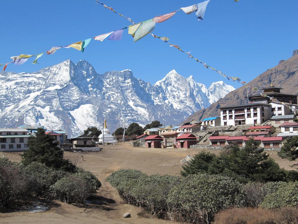 Tengboche Temple, with mountains behind and prayer flags