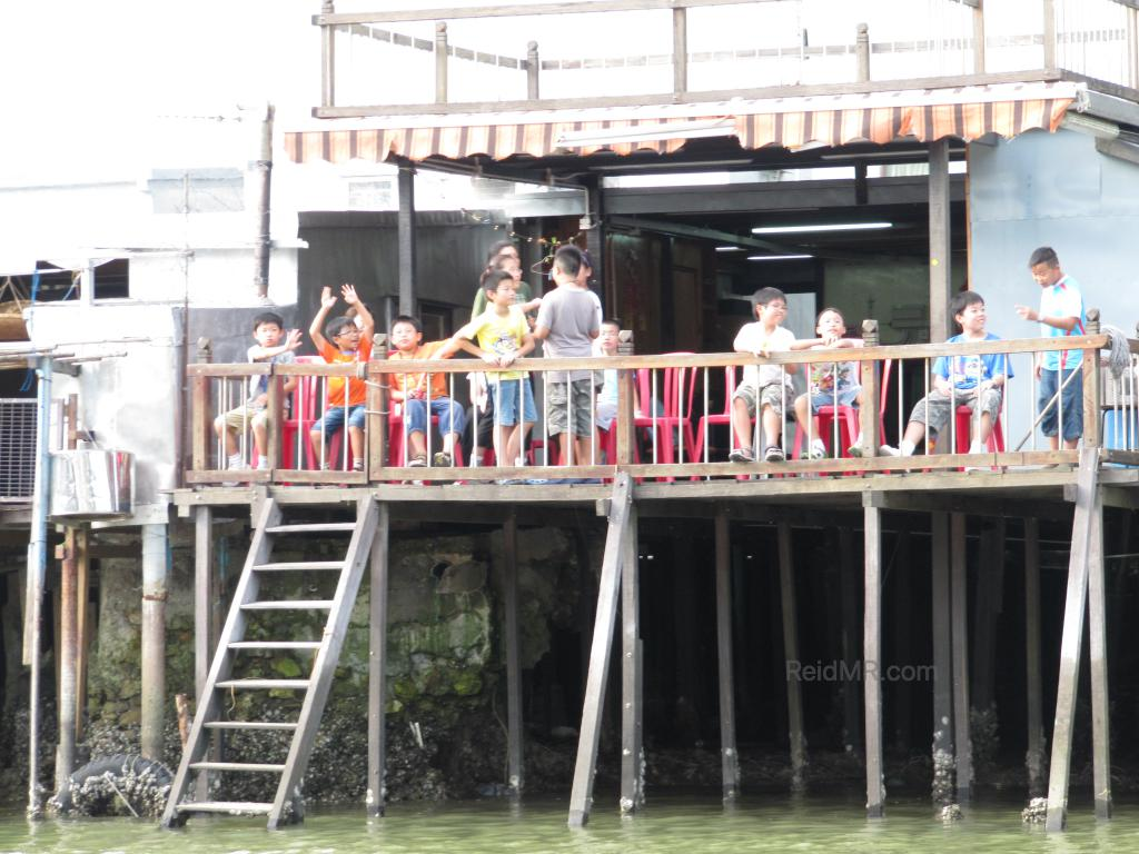 The Tai O school on stilts, with students on the deck