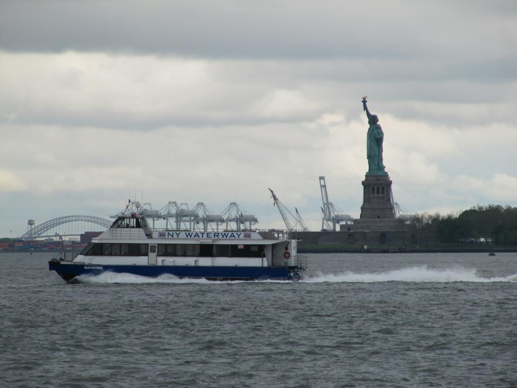 Statue of Liberty with the ferry in front of it