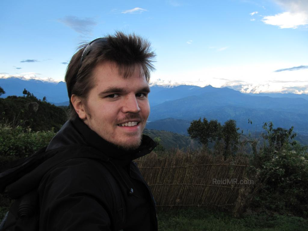 Me with the Himalayan Mountains in the background at Nagarkot