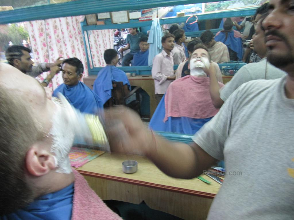 Getting a shave in Dharan, with the foam on my face