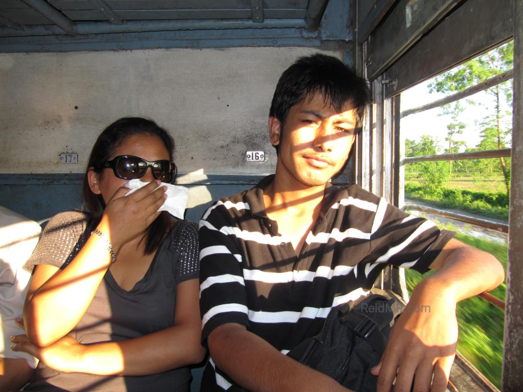 Likee and Rojesh on the Train, Likee covering nose