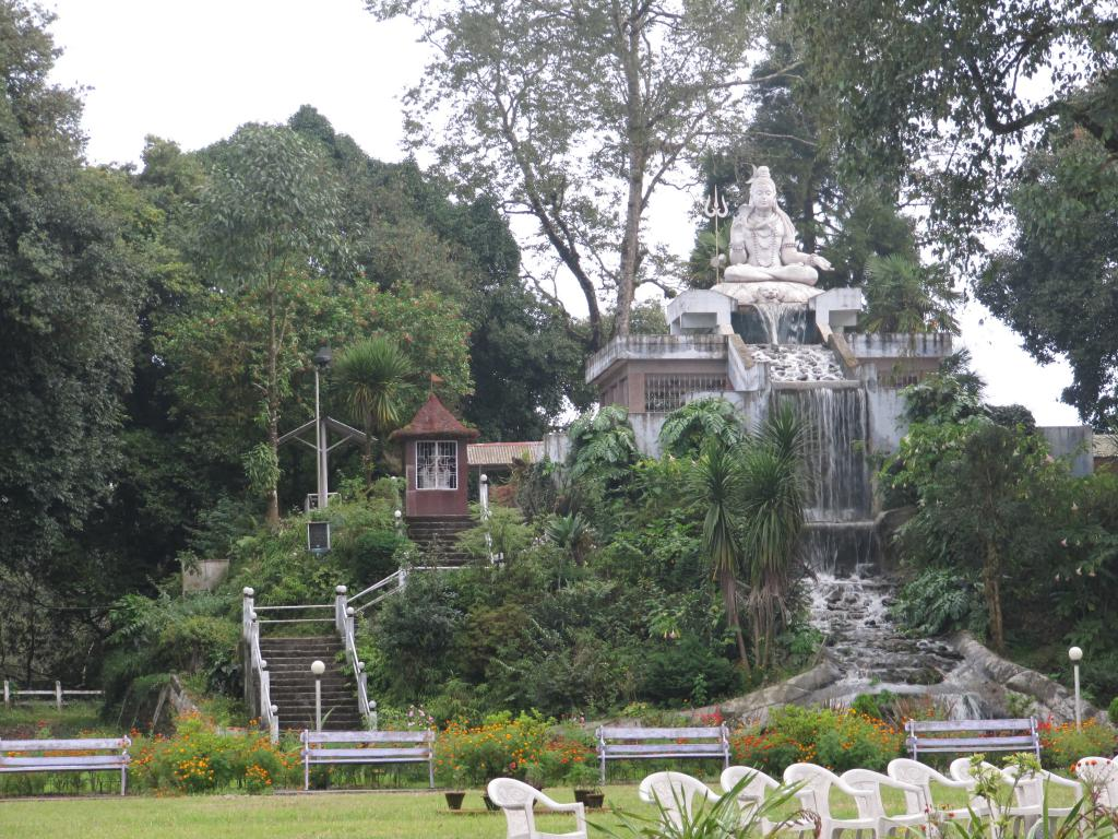 A view of a statue in a park in Darjeeling