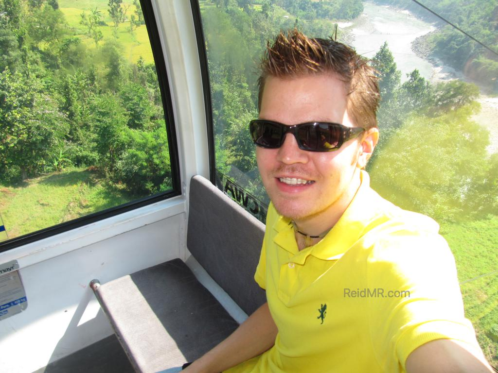 In the Manakamana cable car, with the greenery outside