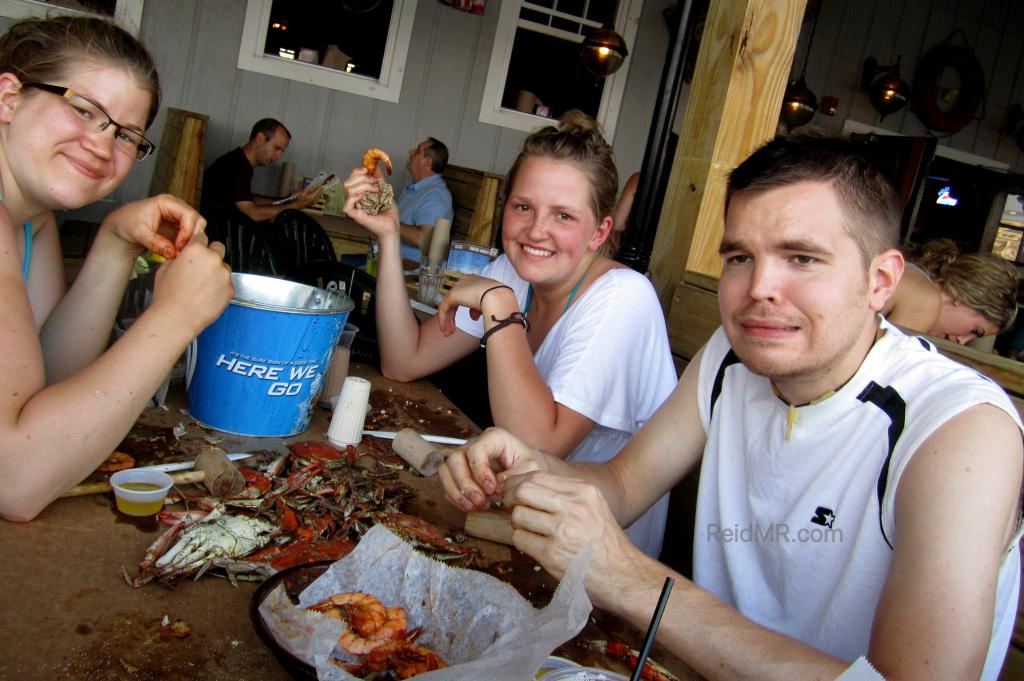 Brittany, Kate, and I are eating crabs. I am making a strange face. (C) 2011 - Lacey. Used with permission.