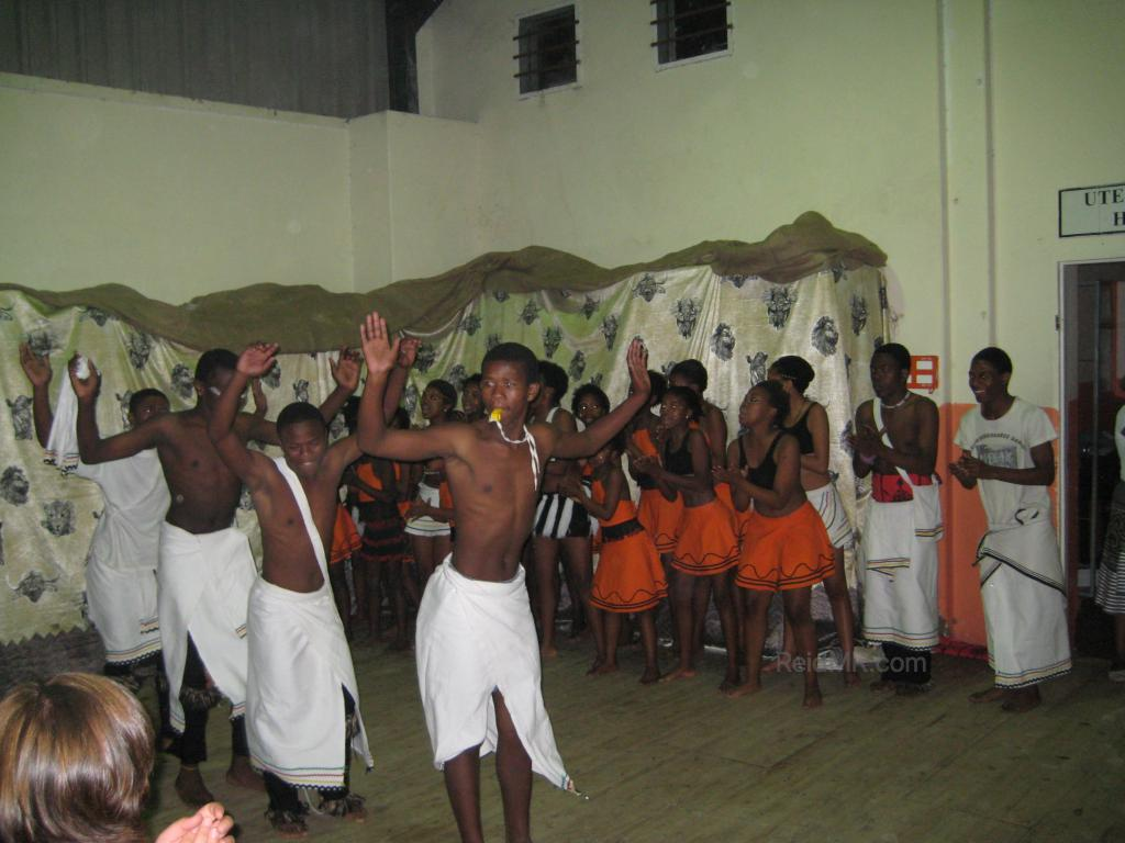 Teenage dancers in the township at our volunteer place. People on the side.