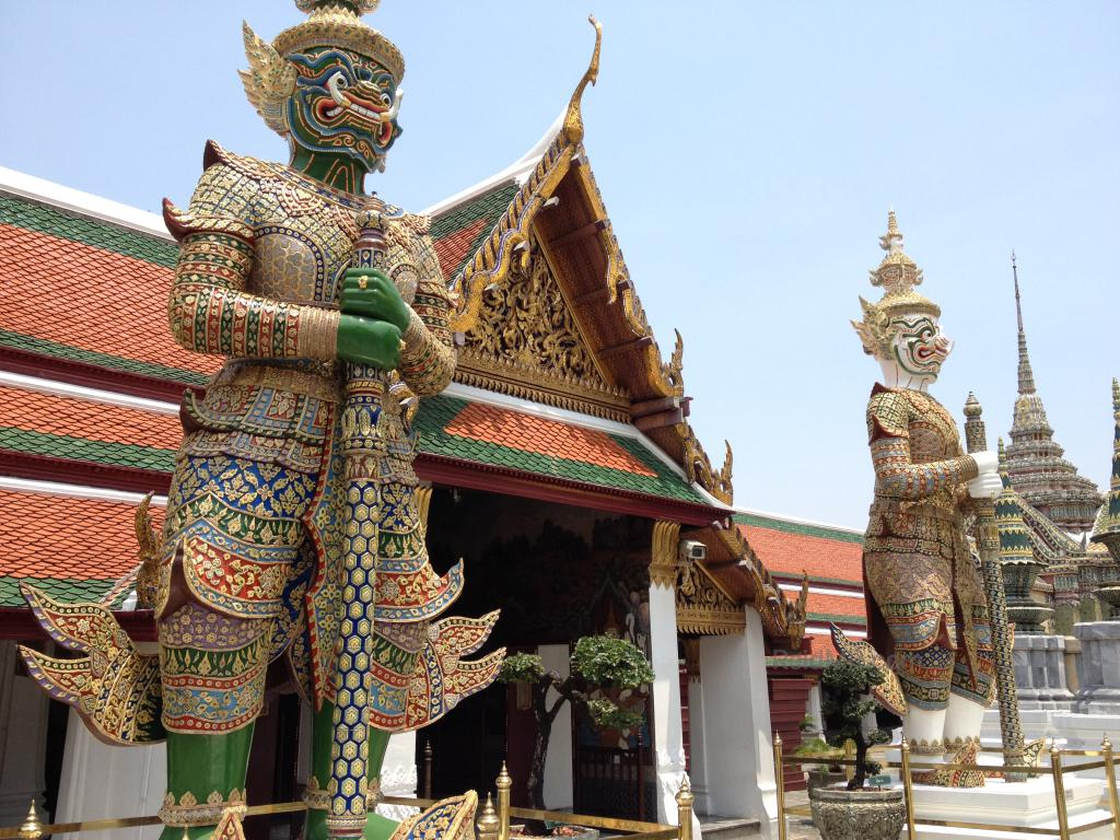 Some of the statues at the Temple of the Emerald Buddha, large ones in the protector/guard position at a doorway