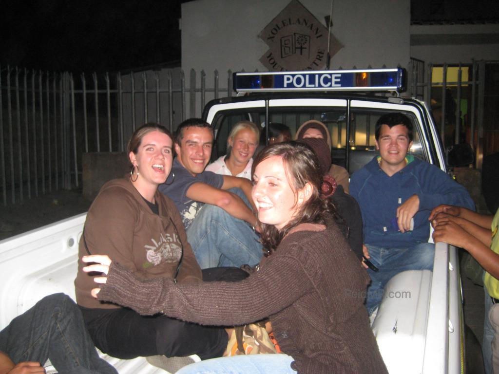 A group of us sitting in the back of the police pickup.