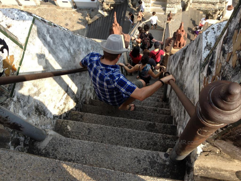 Wat Arun very steep steps with someone going down them