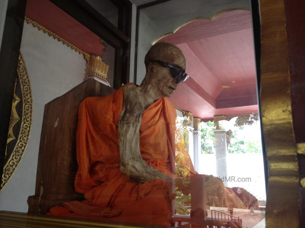 The mummified monk in the glass showcase at Kunaram Temple.