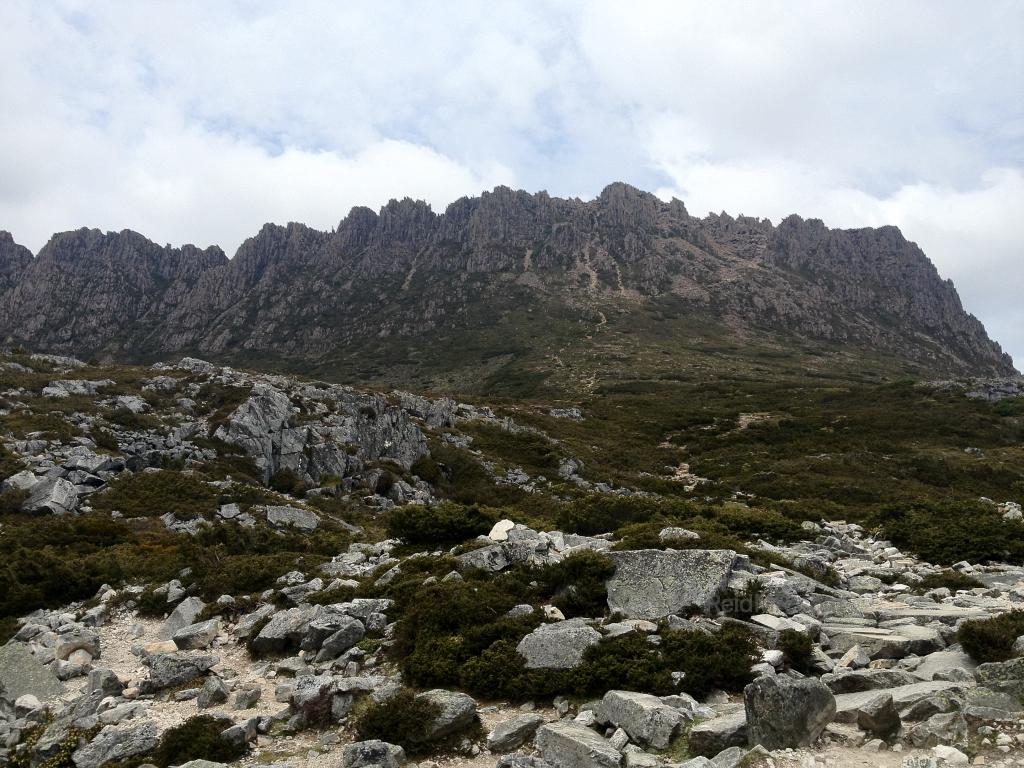 Cradle Mountain with a rocky terrain in the foreground.