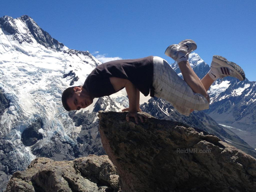 Me doing an elbow lever with Mount Cook and glaciers in the background.
