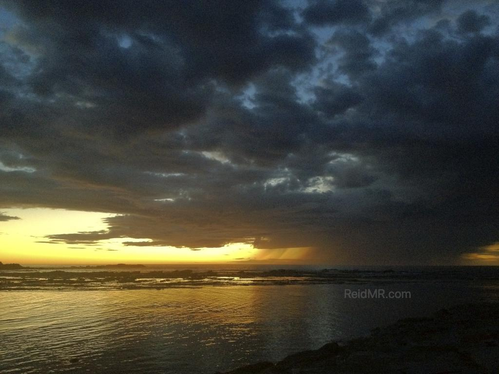 My most memorable sunrise over the ocean with stormy clouds.
